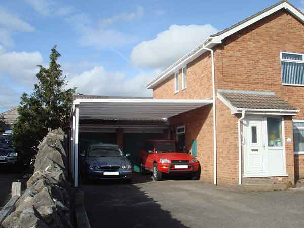 Carport with two cars from Just Home Improvements